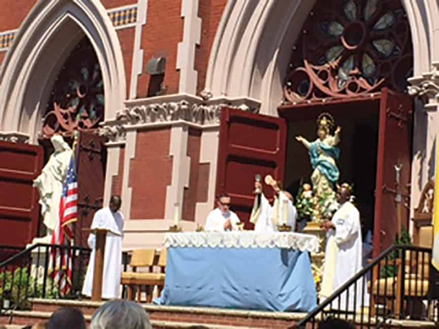 Feast of the Assumption is Celebrated at Outdoor Masses,   By Laura Eng